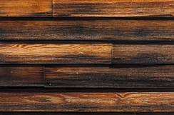 Clapboard siding stained dark brown